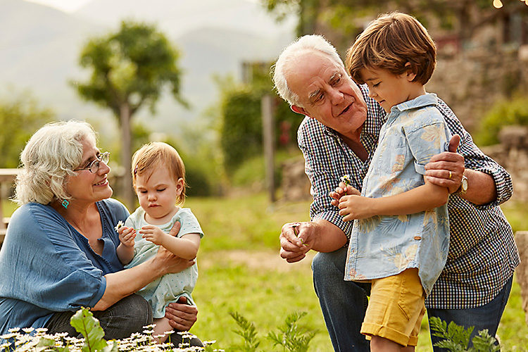 Grand parents together with grand children in a field