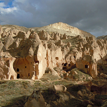Cave dwellings of early Christians in Cappadocia on a cloudy day